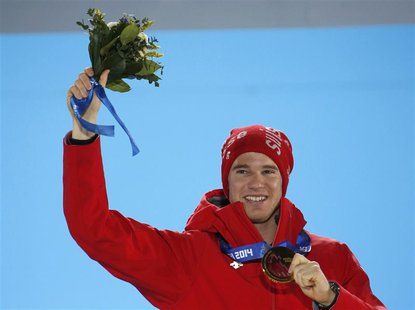 Gold medallist Switzerland's Dario Cologna poses during the victory ceremony for the men's cross-country 15km classic event at the 2014 Soch