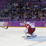 Team USA's T.J. Oshie (L) scores the game winning goal over Russia during a shootout in their men's preliminary round hockey game at the Soc