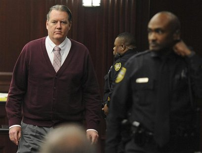 Michael Dunn returns to the courtroom during jury deliberations in his murder trial over the killing of Jordan Davis, in Jacksonville, Flori