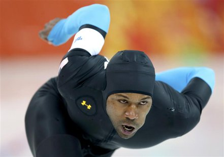 Shani Davis of the U.S. competes in the men's 1,500 metres speed skating race during the 2014 Sochi Winter Olympics, February 15, 2014. REUT