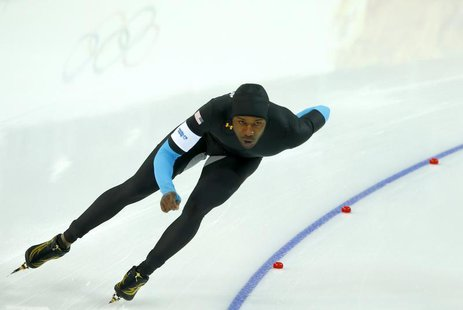Shani Davis of the U.S. competes in the men's 1,500 metres speed skating competition at the 2014 Sochi Winter Olympics, February 15, 2014. R