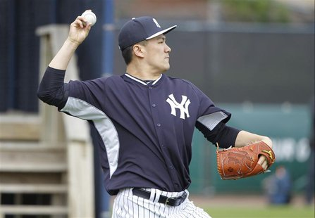Feb 15, 2014; Tampa, FL, USA; New York Yankees starting pitcher Masahiro Tanaka (19) throws the ball during spring training at George M. Ste