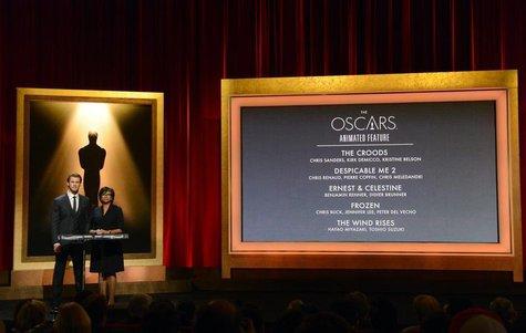 Actor Chris Hemsworth (L) and Academy of Motion Picture Arts and Sciences President Cheryl Boone Isaacs announce the nominees for Best Anima