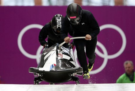 Pilot Elana Meyers (R) of the U.S. starts in a two-women bobsleigh training session at the Sanki Sliding Center in Rosa Khutor, during the S