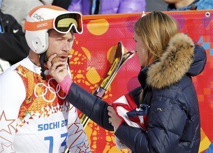 Bode Miller (L) of the U.S. cries next to his wife Morgan Beck in the mixed zone after finishing in the men's alpine skiing Super-G competit