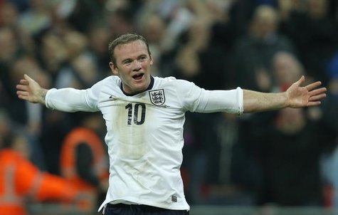 England's Wayne Rooney celebrates after scoring during their 2014 World Cup qualifying soccer match against Poland at Wembley Stadium in Lon