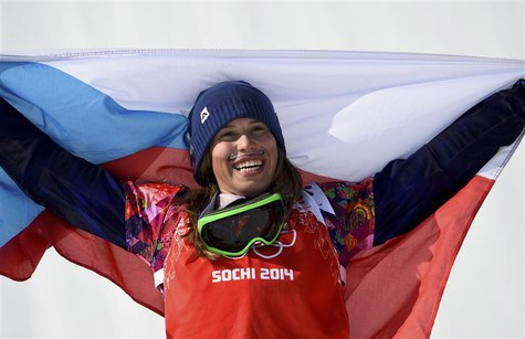 First placed Eva Samkova of the Czech Republic celebrates after the women's snowboard cross finals at the 2014 Sochi Winter Olympic Games in