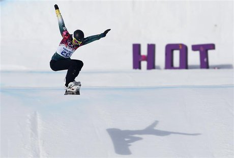 Australia's Torah Bright performs a jump during the women's snowboard cross qualification round at the 2014 Sochi Winter Olympic Games in Ro