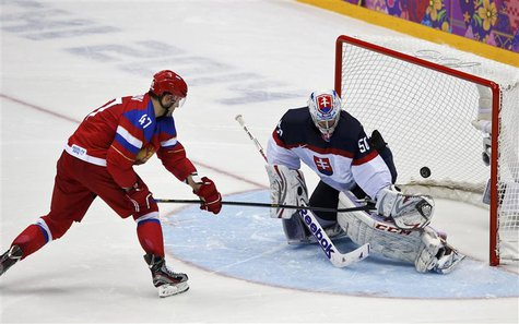 Russia's Alexander Radulov (L) scores on Slovakia's goalie Jan Laco on his team's first shootout attempt during their men's preliminary roun