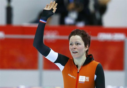 Jorien ter Mors of the Netherlands waves after the women's 1,500 metres speed skating race in the Adler Arena at the Sochi 2014 Winter Olymp