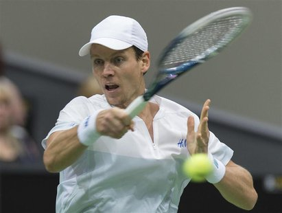 Tomas Berdych of Czech Republic hits a forehand against Marin Cilic of Croatia during their final match of the ABN AMRO tennis tournament in