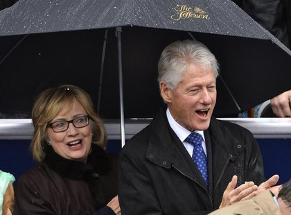 Former U.S. President Bill Clinton (R) and his wife Hillary attend the swearing-in ceremony of Terry McAuliffe as Virginia's governor in Ric