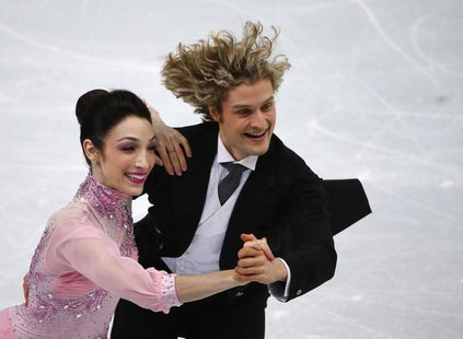 Meryl Davis (L) and Charlie White of the U.S. compete during the figure skating ice dance short dance program at the Sochi 2014 Winter Olymp