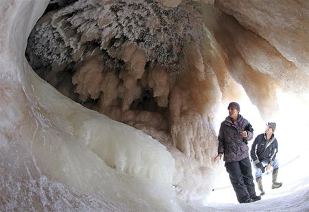 Sightseers look at ice formations in sea caves of the Apostle Islands National Lakeshore of Lake Superior near Cornucopia, Wisconsin Februar