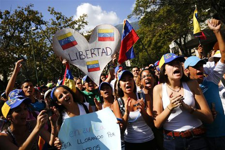 Opposition demonstrators shout slogans during a protest against President Nicolas Maduro's government in Caracas February 16, 2014. REUTERS/
