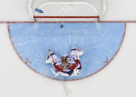 Russia's goalie Sergei Bobrovski reacts after giving up the game-winning goal to Team USA's T.J. Oshie (not seen) during a shootout in their men's preliminary round ice hockey game at the Sochi 2014 Winter Olympic Games February 15, 2014. Credit: Reuters/Mark Blinch