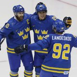 Sweden's Henrik Zetterberg (40) celebrates his goal with teammates Alexander Steen (20) and Gabriel Landeskog (92) during the second period of their men's preliminary round hockey game against the Czech Republic at the Sochi 2014 Winter Olympic Games, February 12, 2014.  Credit: Reuters/Grigory Dukor