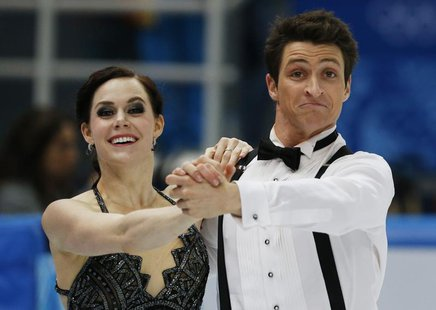 Canada's Tessa Virtue and Scott Moir compete during the Figure Skating Ice Dance Short Dance Program at the Sochi 2014 Winter Olympics, Febr