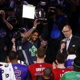 Feb 16, 2014; New Orleans, LA, USA; Eastern Conference Kyrie Irving guard (2) of the Cleveland Cavaliers celebrates with the MVP trophy afte