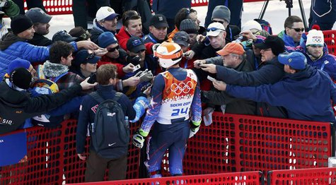 Bode Miller of the U.S. is surrounded by the media during the slalom run of the men's alpine skiing super combined event at the 2014 Sochi W