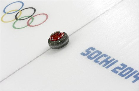 A stone is seen during a women's curling round robin game at the 2014 Sochi Winter Olympics at the Ice Cube Curling Center February 17, 2014