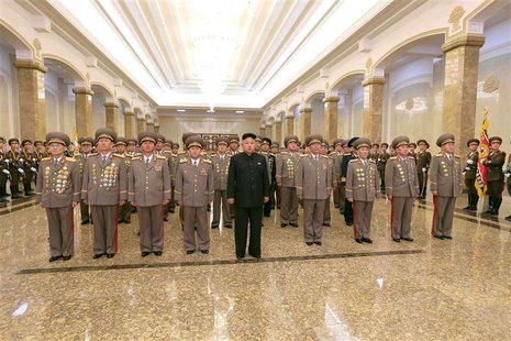 North Korean leader Kim Jong Un (C) visits the Kumsusan Palace of the Sun on the 72nd birth anniversary of North Korea's late leader Kim Jon