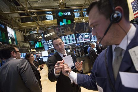 Traders use a paper trading slip on the floor of the New York Stock Exchange February 13, 2014. REUTERS/Brendan McDermid