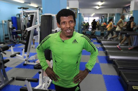 Ethiopian marathon runner Haile Gebrselassie speaks during a Reuters interview in his gymnasium in Ethiopia's capital Addis Ababa, July 16,