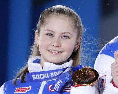 Yulia Lipnitskaya of the gold medal-winning Russian figure skating team poses with her medal during the medal ceremony for the figure skatin
