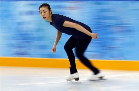 South Korea's Kim Yuna practices her routine during a figure skating training session at the Iceberg Skating Palace training arena during th