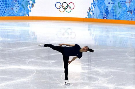 South Korea's Kim Yuna practises her routine during a figure skating training session at the Iceberg Skating Palace training arena during th
