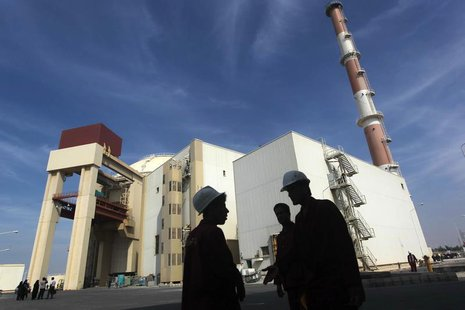 Iranian workers stand in front of the Bushehr nuclear power plant, about 1,200 km (746 miles) south of Tehran October 26, 2010. REUTERS/Mehr