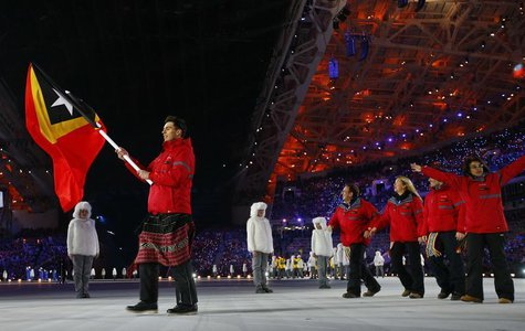 Flag-bearer Yohan Goncalves of Democratic Republic of Timor-Leste leads his country's delegation during the opening ceremony of the 2014 Soc
