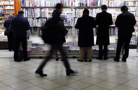 People browse a bookstore at a train station in Tokyo February 17, 2014. REUTERS/Yuya Shino