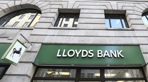 The signage is seen at a branch of Lloyds bank in central London February 13, 2014. REUTERS/Paul Hackett (