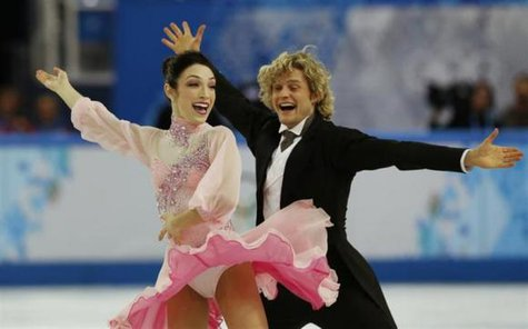 Meryl Davis and Charlie White of the U.S. compete during the Figure Skating Ice Dance Short Dance Program at the Sochi 2014 Winter Olympics, February 16 2014.  Credit: Reuters/Alexander Demianchuk