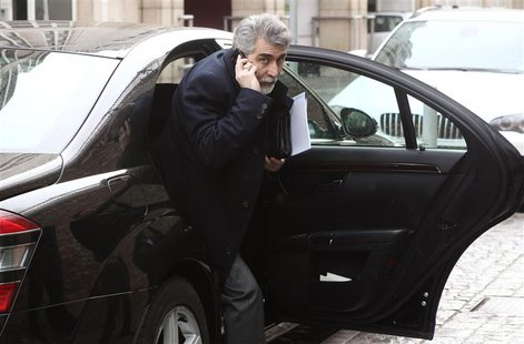 Iran's ambassador to Austria Hassan Tajik leaves his limousine as he arrives at a hotel in Vienna February 17, 2014. REUTERS/Heinz-Peter Bad