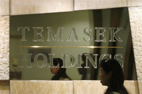 An employee walks past a Temasek Holdings sign at the company's headquarters in Singapore in this August 2, 2007 file photo. REUTERS/Vivek P
