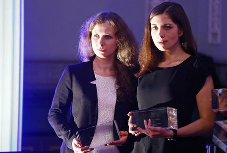 "Russian punk band Pussy Riot members Maria Alyokhina (L) and Nadezhda Tolokonnikova pose after winning a trophy in the category ""Most Valuab"
