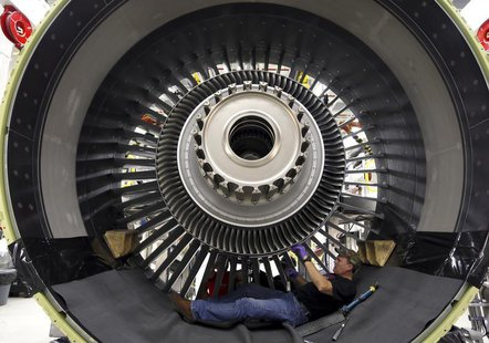 General Electric employee Jim Jones assembles a GE90 engine at the GE Aviation Peebles Test Operations Facility in Peebles, Ohio, November 1