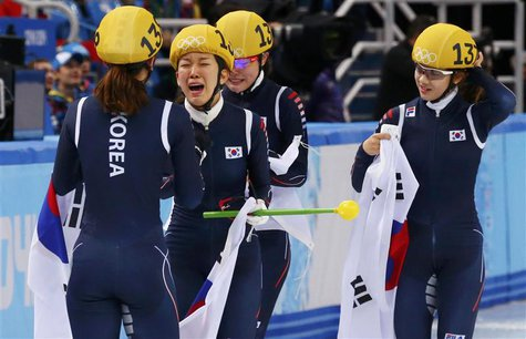 South Korea's skating team celebrates after winning the women's 3,000 metres short track speed skating relay final event in the Iceberg Skat