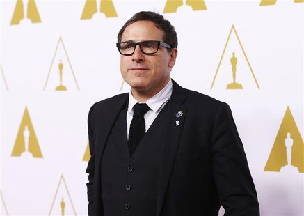 Best director nominee David O. Russell arrives at the 86th Academy Awards nominees luncheon in Beverly Hills, California February 10, 2014.