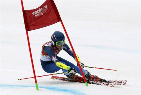 Mikaela Shiffrin of the U.S. clears a gate during the second run of the women's alpine skiing giant slalom event at the 2014 Sochi Winter Ol