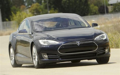 A Tesla Model S electric sedan is driven near the company's factory in Fremont, California, June 22, 2012. REUTERS/Noah Berger