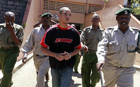 British citizen Jermaine Grant (C) is escorted into court for a hearing in the Kenyan coastal town of Mombasa May 9, 2012. REUTERS/Joseph Ok