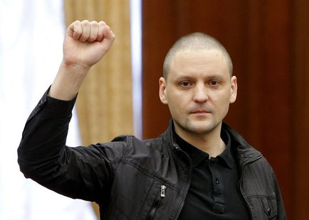 Opposition leader Sergei Udaltsov gestures during a court hearing in Moscow February 18, 2014. REUTERS/Maxim Shemetov