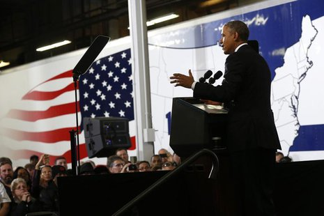 U.S. President Barack Obama speaks about the economy and fuel standards during a visit to a Safeway Distribution Center in Upper Marlboro, M