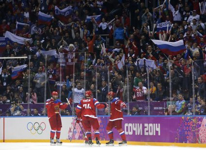 Russia's Ilya Kovalchuk (R) celebrates his goal against Norway with teammates Alexei Yemelin (C) and Alexander Radulov (L) during the second