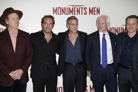 Cast members Bill Murray (L-R), Jean Dujardin, George Clooney, writer Robert Morse Edsel and actor Matt Damon arrive for the French premiere