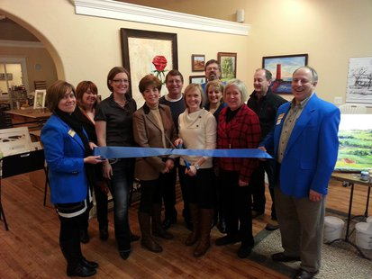 The official ribbon cutting for the new location for Cassy Tully - Fine Arts LLC in Plymouth.